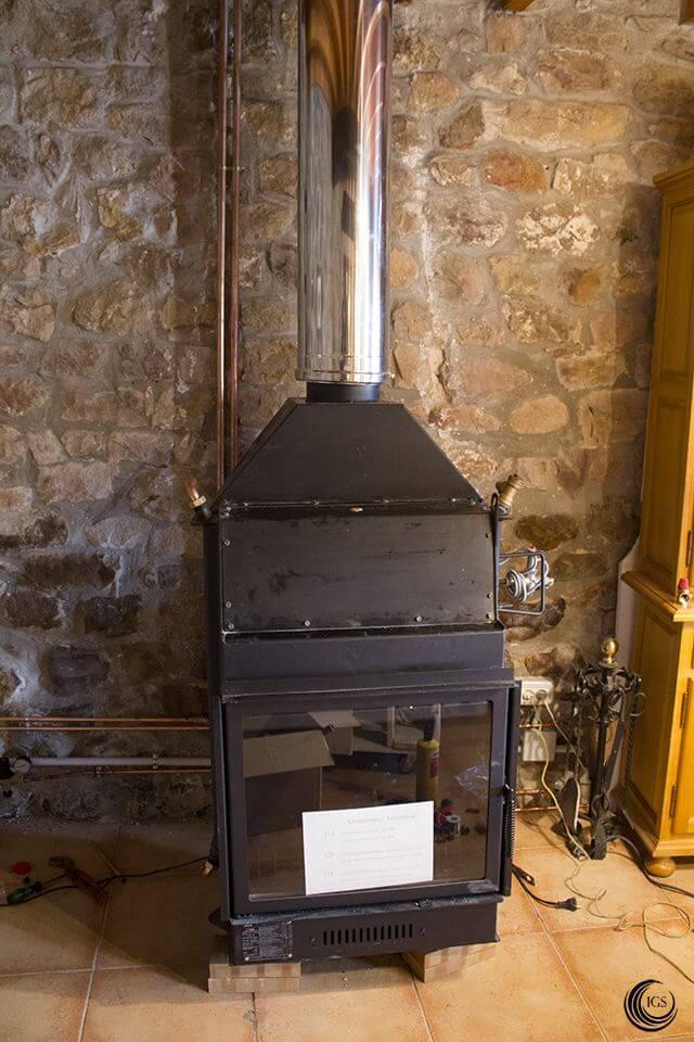 Calefacci n termochimenea de le a con radiadores calor - Calefaccion lena radiadores ...